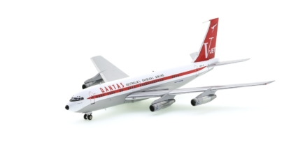 Front port side view of Inflight200 IF7071JTP - 1/200 scale diecast model of the Boeing 707-138B, registration N707J, owned by John Travolta in the livery of Qantas